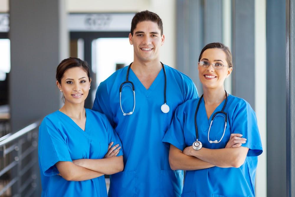 Three doctors standing in uniform