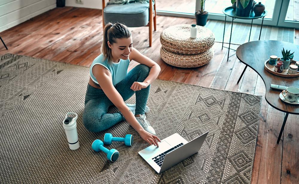 Sport Women Sitting On Floor In Sportswear