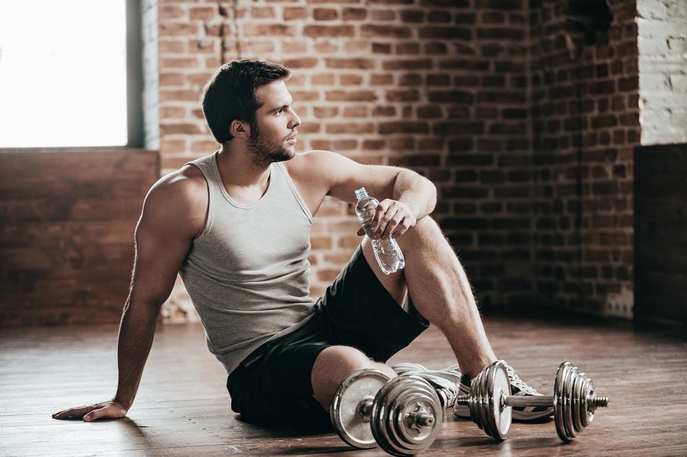 Man wearing athleisure Tank top at gym