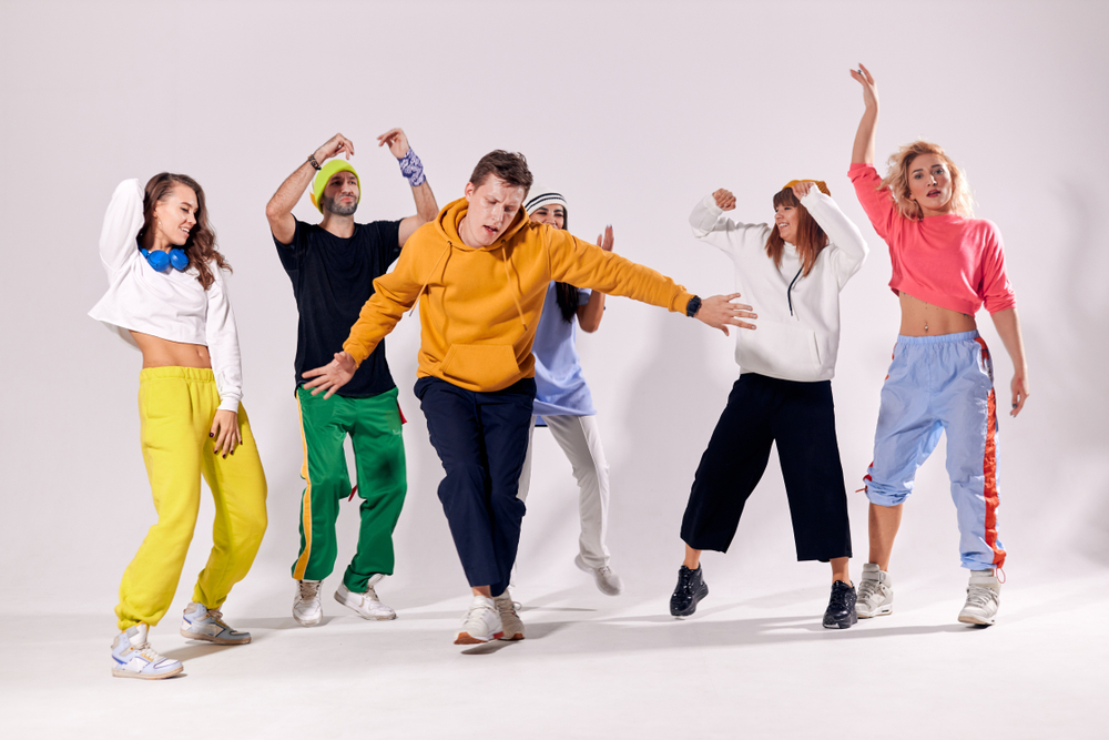 Group of dancers wearing athleisure shirts